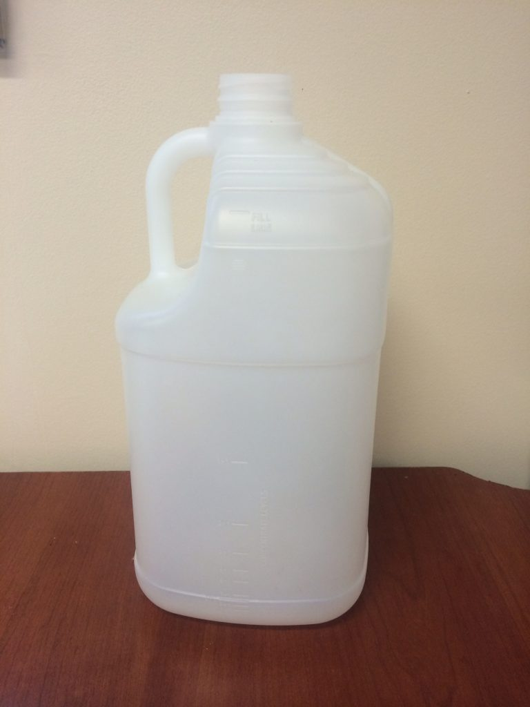 food and beverage white plastic jug with measurements on the side food safe