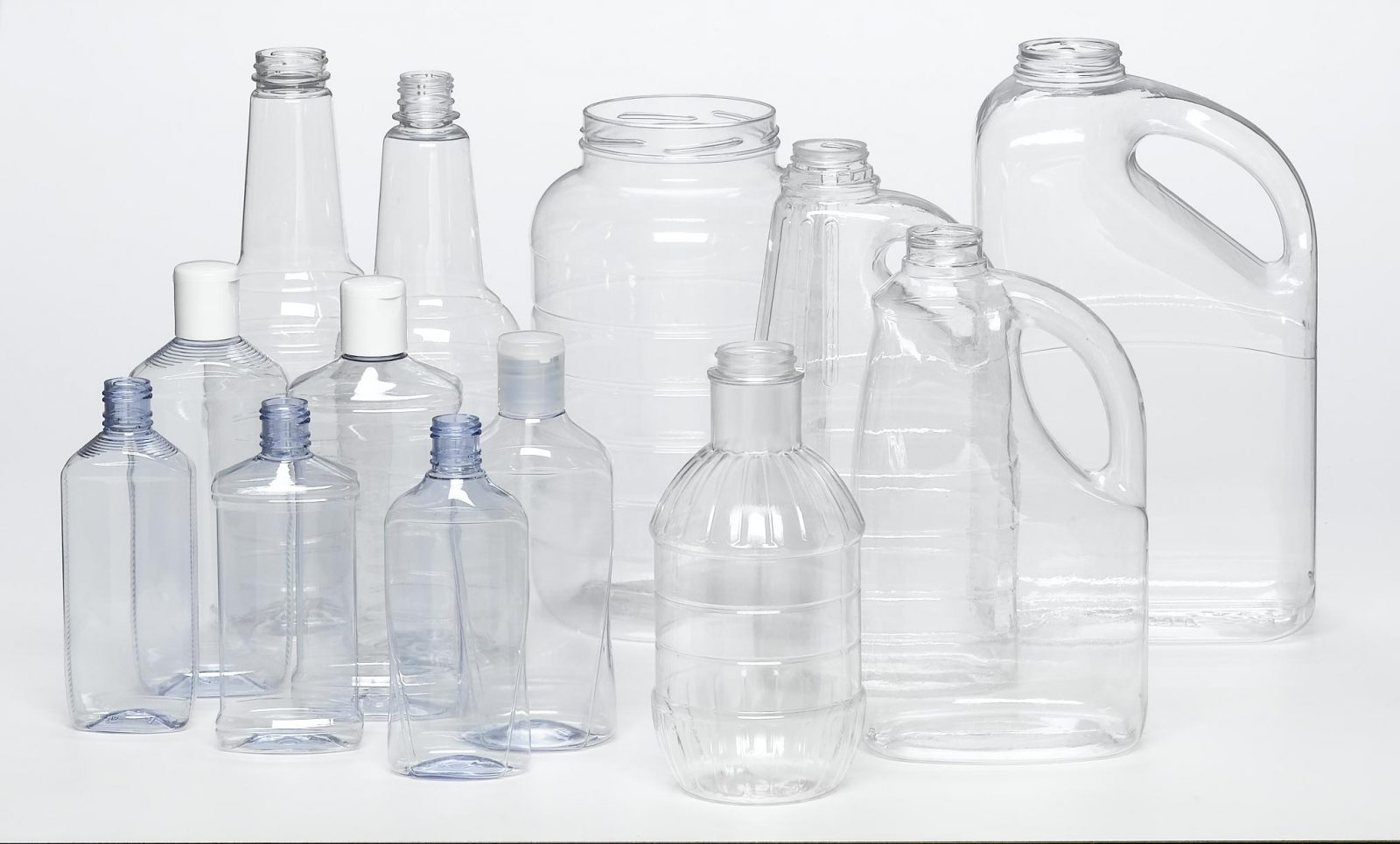 PET various sized clear plastic jugs with screw tops