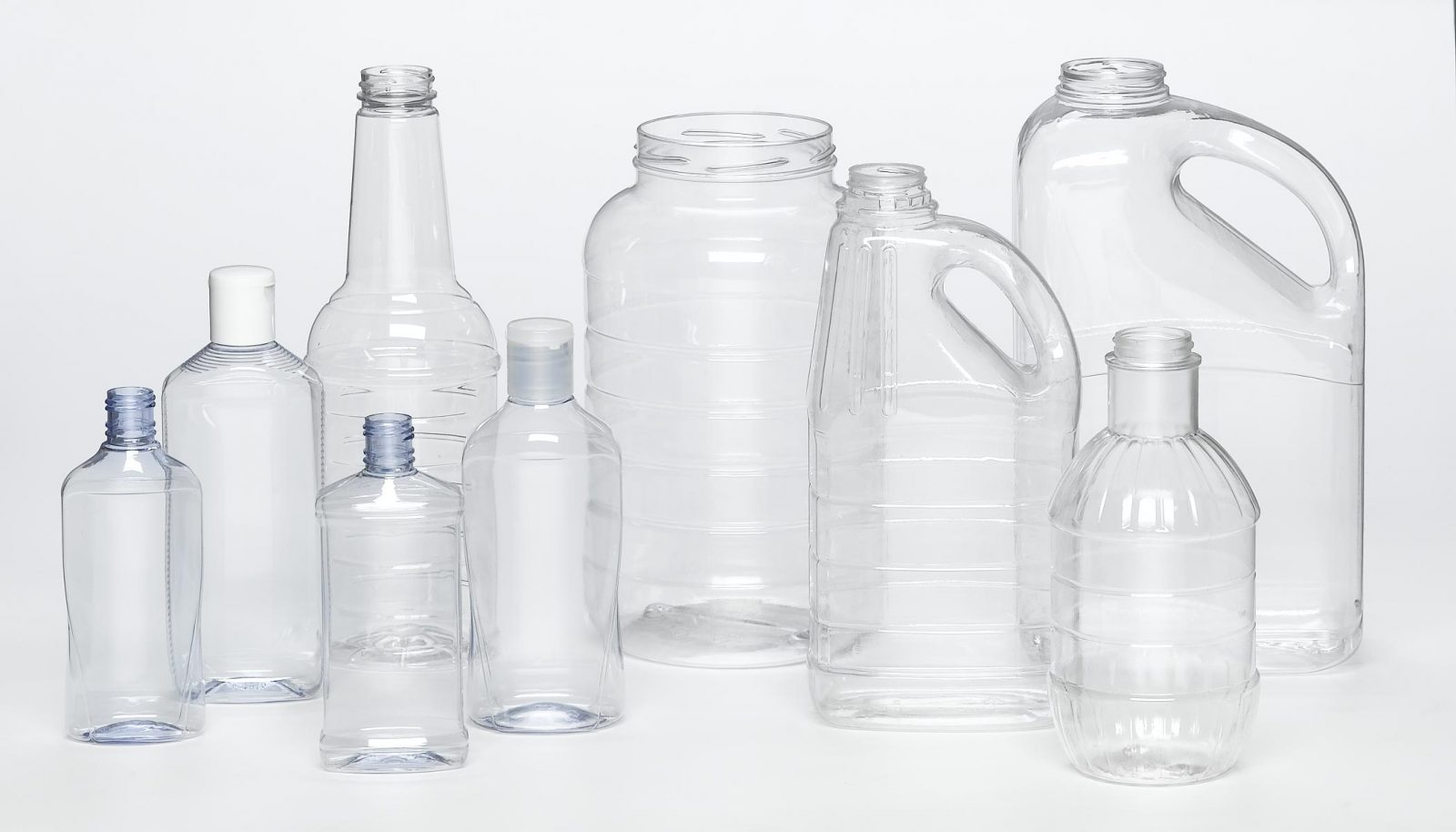 PET clear plastic bottles of various shapes and sizes
